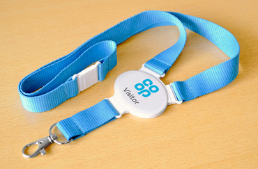 Printed and domed snap lanyards - Oval lanyard with a light blue strap | www.namebadgesinternational.co.uk